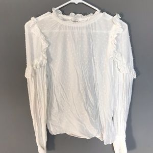 Blouse with ruffle shoulders